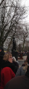 The Dockworker statue, with a woman wearing red, remembering the communist organizers